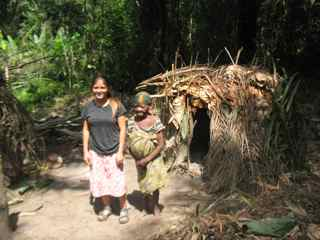April with an old Pygmy lady in front of her hut 5
