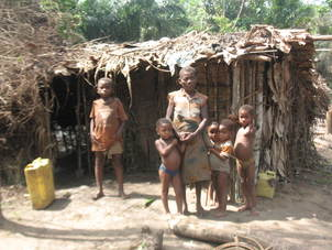 Pygmy family and their home