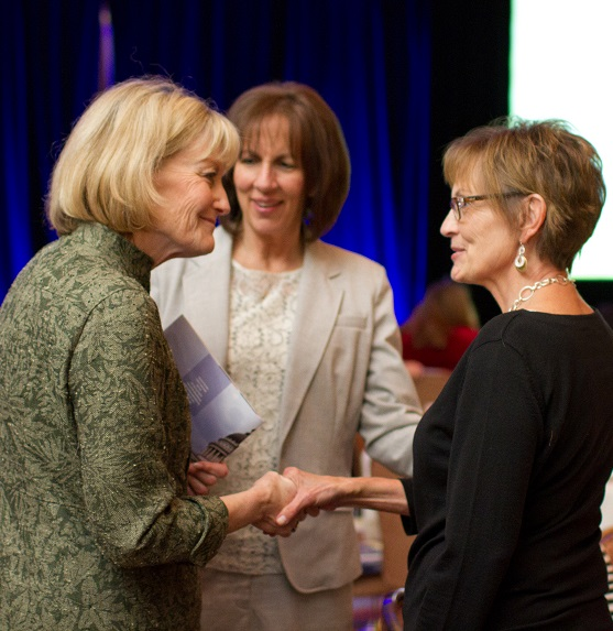 Jan Zogmaister, center, chats with others at Sutherland dinner