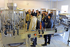 APEC participants view a bottling line.