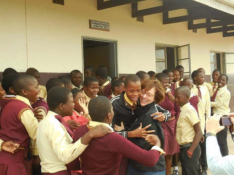 2014 traveler Shari with kids at Jevu Secondary School.