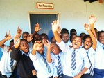 Umphezeni School children waving a greeting to the US