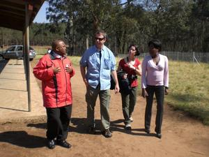 Dave, Michelle, and Lungile talking to the principle at the Mcakwini School