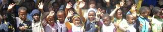 Ntatshana Primary School children waving in thanks for their new classroom