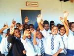 Umphezeni School children waving a greeting to the US