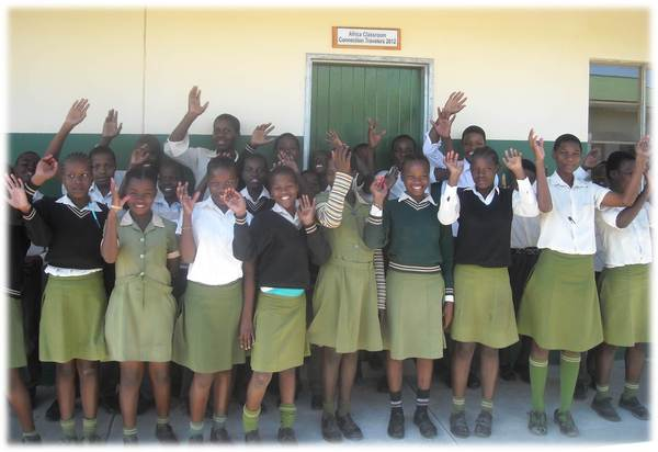 Happy learners at Gobihlahla School pose in front of their new classroom built with funds raised by 2012 Learning Tour participants.