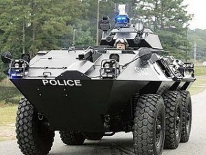 aa-police-state-police-tank-riding-down-road-good-one-300x226