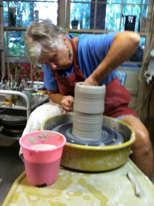 Ann Wallin on potters wheel - cylinder