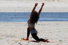 gal-doing-yoga-on-beach 2