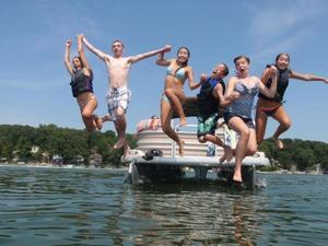 kids jump off boat