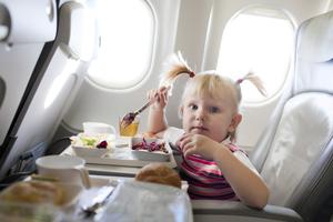 Little Girl Eating on the Plane