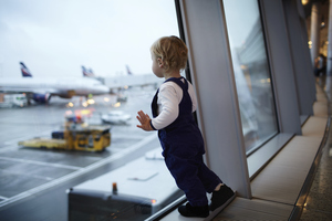 Boy looking at the planes
