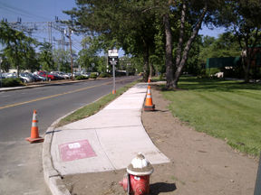 Schlumberger sidewalk and curb ramp